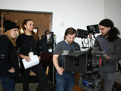 production crew with cameras and scripts
