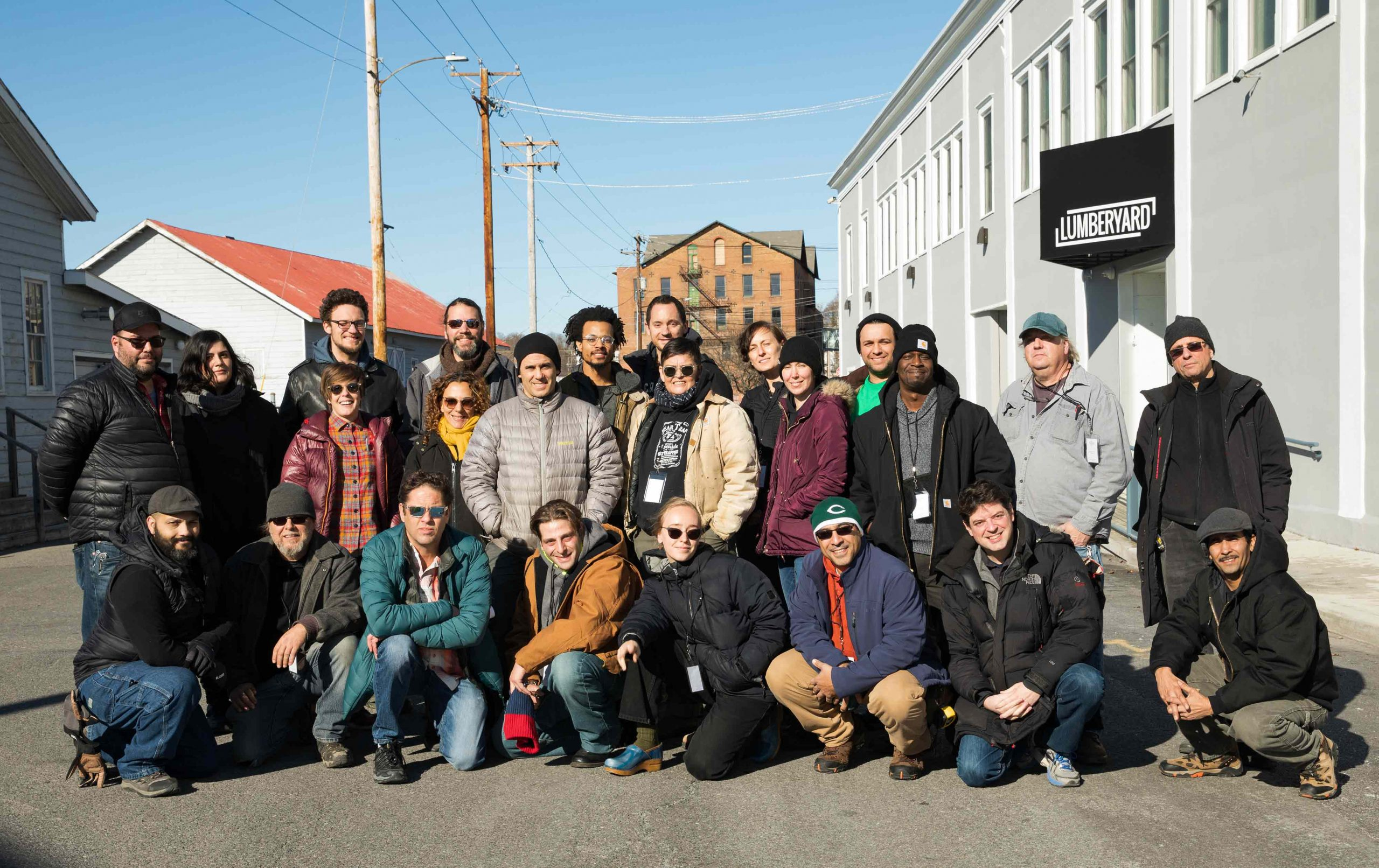 group photo of crew members outside in the winter weather